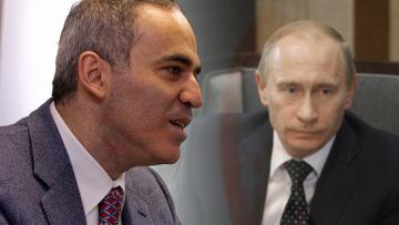 Лидер Объединенного гражданского фронта Гарри Каспаров. В.В.Путин на заднем плане