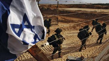 Израильские резервисты входят в сектор Газа