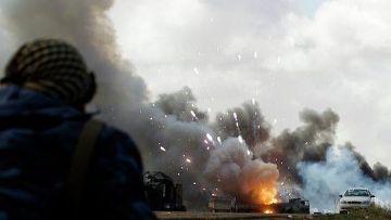 авиаудары по силам Каддафи на южной окраине Бенгази