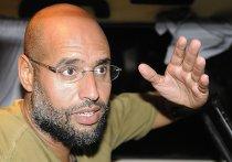 Якобы арестованный сын Каддафи - Сейф аль-Ислам Каддафи - прокатился с журналистами по Триполи