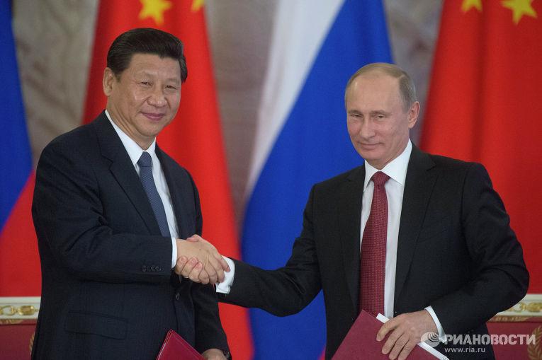 Владимир Путин и Си Цзиньпин на подписании совместного заявления о взаимовыгодном сотрудничестве и углублении отношений, всеобъемлющего партнерства и стратегического взаимодействия.
