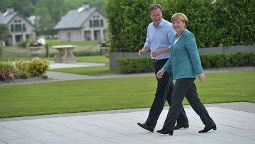 Премьер-министр Великобритании Дэвид Кэмерон и канцлер Германии Ангела Меркель