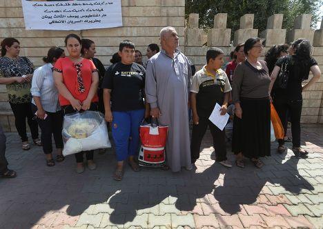 Иракские христиане – беженцы из деревни в окрестностях Мосула