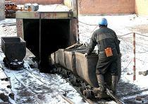 Китайский шахтер в угольной шахте. Архивное фото