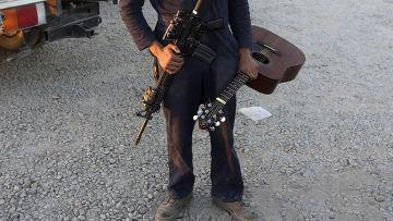 Американский солдат готовится покинуть военную базу в провинции Гильменд