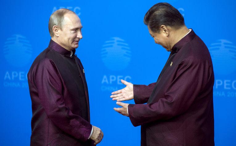 Владимир Путин и председатель КНР Си Цзиньпин на саммите АТЭС в Пекине