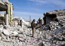 Боец курдского сопротивления на улице Кобани