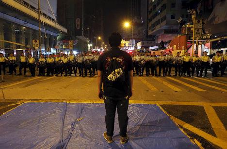Участник акции протеста в Гонконге, октябрь 2014 года