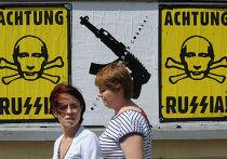 Плакат с изображением Владимира Путина в Варшаве
