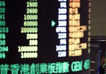 Мониторы Гонконгский фондовой биржи, показывающие индекс Hang Seng