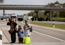 Мигранты неподалеку от пункта Реске, Венгрия. 9 сентября 2015