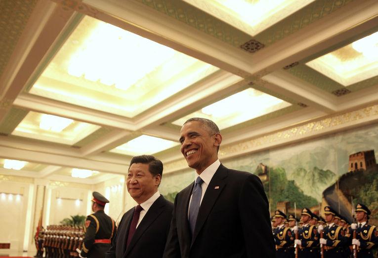 Председатель КНР Си Цзиньпин и президент США Барак Обама во время встречи в Пекине
