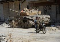 Боевая техника 4-й дивизии Сирийской Арабской Армии  на передовой позиции в пригороде Дамаска Дарайе