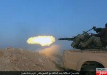 Боевик «Исламского государства» во время боя с сирийской армией в провинции Хомс