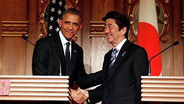 Президент США Барак Обама и премьер-министр Японии Синдзо Абэ на совместной пресс-конференции в Токио. 24 апреля 2014