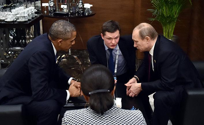"""Президент России Владимир Путин во время беседы с президентом США Бараком Обамой на полях саммита """"Группы двадцати"""" (G20)"""