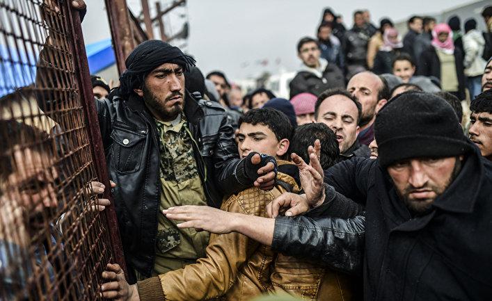 Біженці влаштували тисняву на Сирійсько-Турецької кордоні