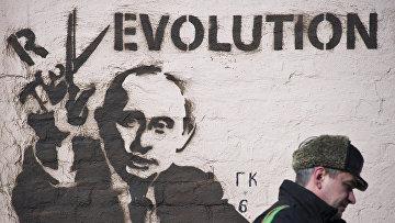 Граффити с изображением президента России Владимира Путина в Москве