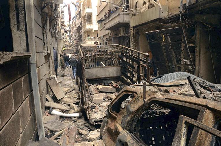 Разрушенные дома в бывшем христианском районе Алеппо