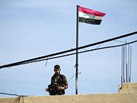 Солдат в городе Маарзаф в Сирии