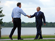 Британский премьер-министр Дэвид Кэмерон и президент России Владимир Путин