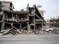 Разрушенные дома на одной из улиц Пальмиры