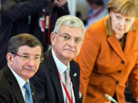 Канцлер Германии Ангела Меркель и премьер-министр Турции Ахмет Давутоглу во время встречи в Брюсселе