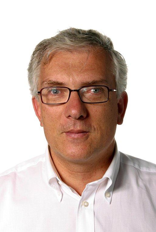 Швейцарский журналсит Ги Меттан