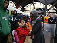 Беженцы из Сирии на железнодорожной станции в Копенгагене