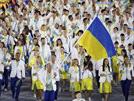 Парад атлетов и членов национальных делегаций на церемонии открытия XXXI летних Олимпийских игр в Рио-де-Жанейро.