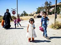 Сирийские беженцы в городе Джераблус, Сирия. Сентябрь 2016