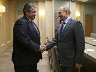 Президент РФ Владимир Путин во время встречи с вице-канцлером, министром экономики и энергетики Германии Зигмаром Габриэлем