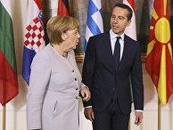 Канцлер Германии Ангела Меркель и канцлер Австрии Кристиан Керн в Вене