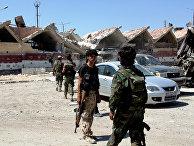 Бойцы сирийской армии на территории освобожденного района Рамусе на юге Алеппо