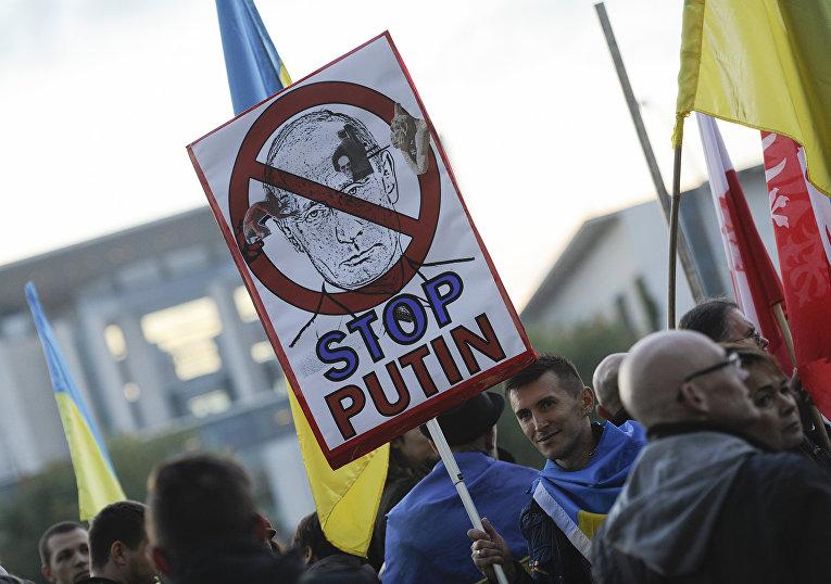 Акция протеста в преддверии встречи лидеров России, Украины, Франции и Германии