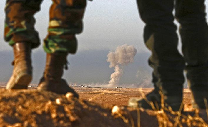 Бойцы курдского военизированного формирования пешмерга в 25 километрах к северо-востоку от Мосула