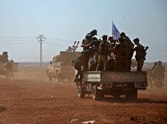 Бойцы Свободной сирийской армии в сирийском поселке Бераан