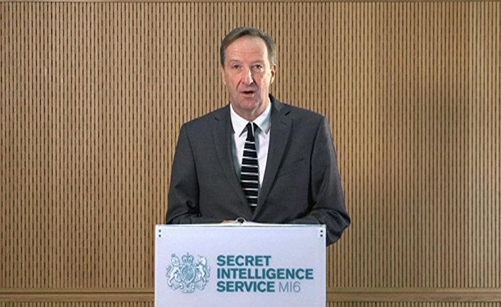 Глава британской секретной разведывательной службы MI6 Алекс Янгер выступает в Лондоне