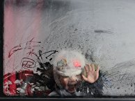 Мальчик в автобусе, предназначенном для эвакуации из Авдеевки