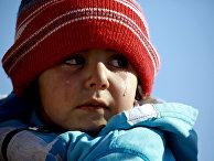 Плачущий ребенок в лагере беженцев «Аль-Хол»