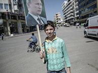 Участник митинга в поддержку президента Сирии Башара Асада и президента России Владимира Путин в Латакии
