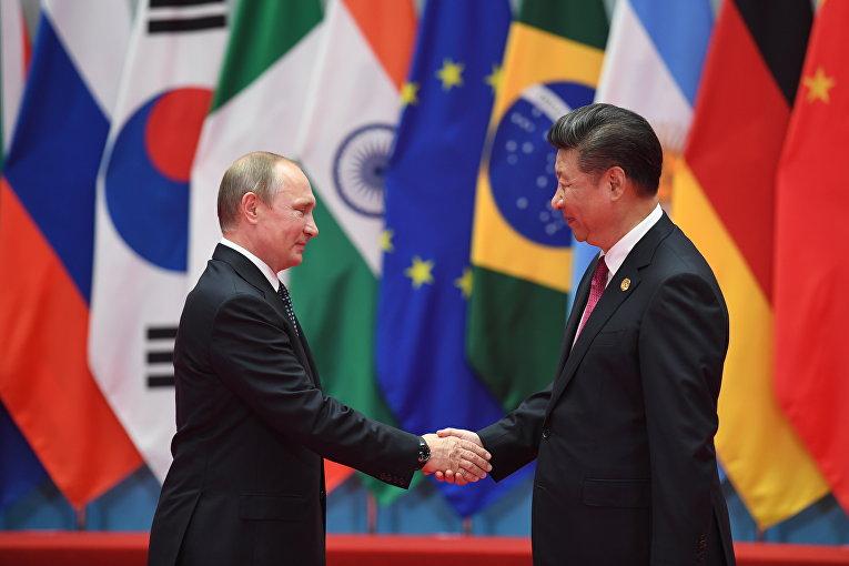 Президент России Владимир Путин и председатель КНР Си Цзиньпин во время встречи в Ханчжоу, КНР