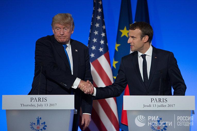 Президент США Дональд Трамп и президент Франции Эммануэль Макрон на совместной пресс-конференции в Париже. 13 июля 2017