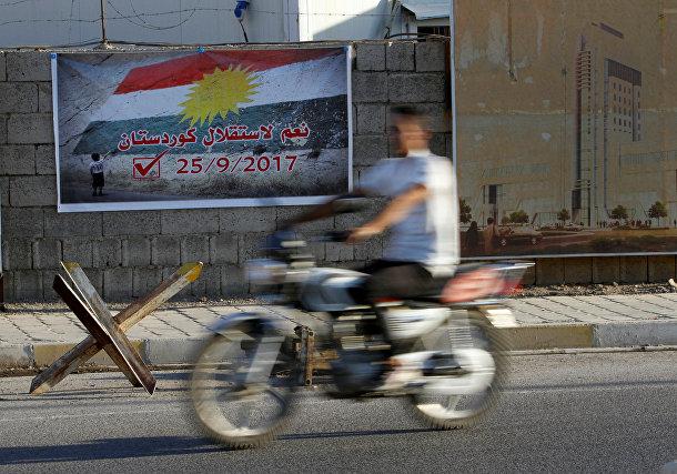 Плакат, призывающий голосовать за независимость Курдистана в городе Киркук, Ирак