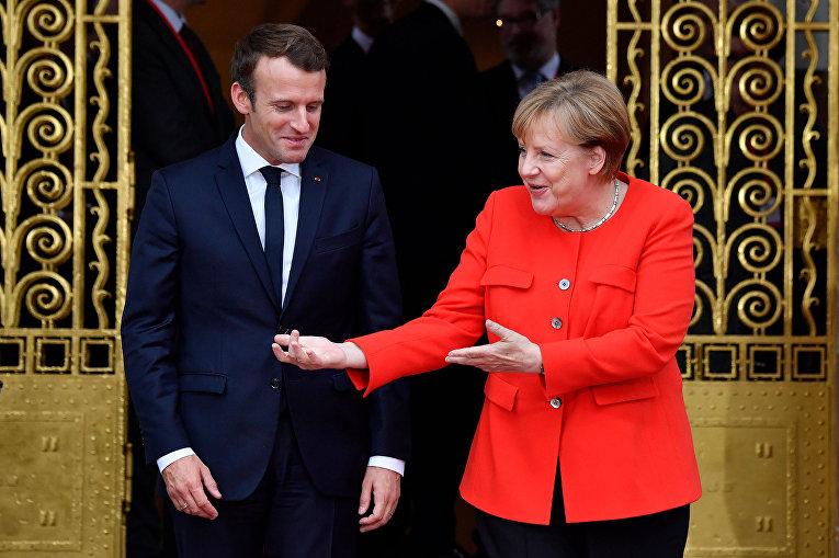 Президент Франции Эммануэль Макрон и канцлер Германии Ангела Меркель во время двусторонних переговоров во Франкфурте-на-Майне