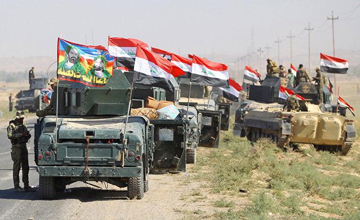 Иракские вонные продвигаться к городу Киркук в ходе операции против курдских боевиков. 16 октября 2017