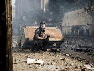 Французский фотограф Реми Ошлик освещает демонстрации в Каире