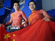 Китайские болельщики во время хоккейного матча на XXI зимних Олимпийских играх в Ванкувере